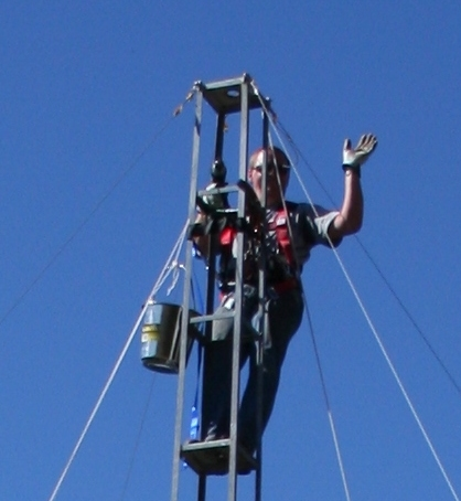 Photo of Gary up the mast